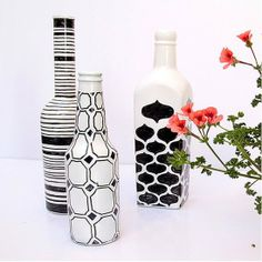 spray painted wine/beer bottles white, black sharpee geometric and fancy designs on top
