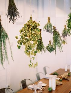 Hang dried herbs over the dinner table for beautiful and fragrant decor - Kinfolk Magazine
