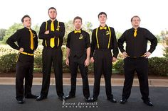 """These """"bridesdudes"""" worked in the Bat-Signal on their boutonnières, which perfectly accentuated their black and yellow attire."""