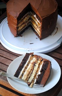 Ultimate S'more Cake - Layers of Brownie, Cheesecake, Chocolate Chip Cookie, Chocolate Frosting, and Marshmallow Fluff! (Recipe)