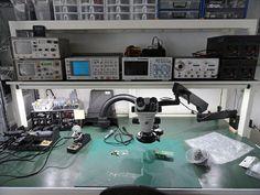 Clean, white electronics workbench closeup.