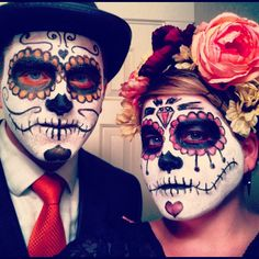 Sugar skull couple. Dia de Los muertos. Day of the dead costume.