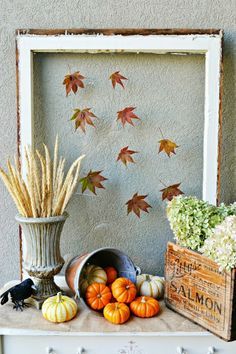 25  Outdoor Fall Decor Ideas.  Love the simple leaves on this window or picture frame.