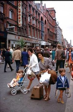 Henry Street Dublin 1960s - always busy and bustling with shoppers. Woolworths on left much loved for Christmas shopping. In the foreground one of the women is about to carry home a parriffin heater. The little boy is carrying a set of pram wheels and will probably use them to make a trolley with twine steering for whizzing down hills. ! Ireland Pictures, Images Of Ireland, Old Pictures, Old Photos, Dublin Ireland, Ireland Travel, Erin Go Bragh, Ireland Homes, Dublin City