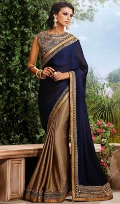 Bring forth your admirable looks in the occasion draping this beige and navy blue embroidered chiffon satin half n half sari. The ethnic lace, resham and stones work for saree adds a sign of beauty statement for the look. #PartyLookDesignerSaree