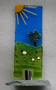 An idea for mounting fused glass http://www.fusionglass-art.co.uk/products/sculptures