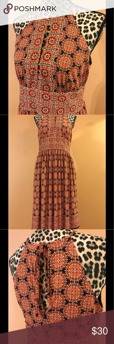 Gorgeous Patterned Mid Length Dress Beautiful print dress with keyhole opening in front and tie back closure with zipper! London Times Dresses Midi