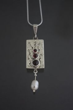 Box Pendant with Garnets by GldnRamMtlsmithing on Etsy by Kathy Anderson