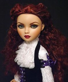Former Ellowyne Wilde Chills, repaint restyle by Sam Halo, Halo Repaints. This is the artist's photo.  Her hair was rooted with a mix of dark brunette, mahogany, and raspberry pink along the underside of her hair and around the crown with a concentration of pink at the top.