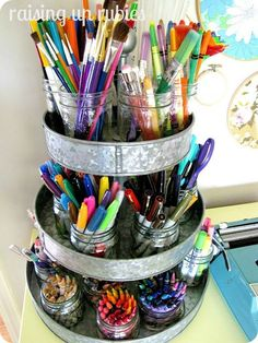 If you have more than a few mason jars worth of crafting supplies, try stacking them on a food/cake stand to help save space on your work table.
