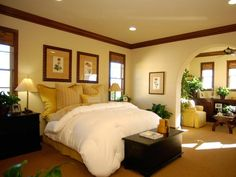 A Bedroom With Definition: The archway is an elegant element in this bedroom and delineates a retreat area from a relaxing sleeping experience.   From HGTVRemodels.com