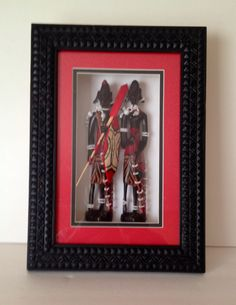 Wood Carvings in Shadow Box Frame - Maasai Man and Woman: Beautifully excecuted, this piece is a MUST buy for any African Arts lover. These sculptures are even maticulously adorned in tradisional jewelry.