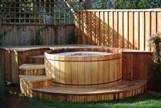 cedar hot tub with custom deck surround and led riser lights