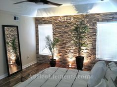 I love these faux stone panels to turn the living room/kitchen divider wall into a nice accent wall!