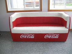 OMG I have got to get one of these for a game room!! Coca cola couch