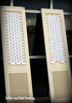Awesome wedding place card idea. Using these shutters to display the wedding name cards made it so easy for guest to find their table information.   Zeffert and Gold Catering, Baltimore Museum of Industry Wedding Catering