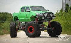 Green Toyota Hilux on Rockwells