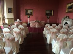 Love the vintage feel of the wedding ceremony in The Douglas Suite, Haigh Hall.  We dressed the chairs in ivory cotton chair covers with a beautiful vintage dusky pink sash.  www.am-flowers.co.uk