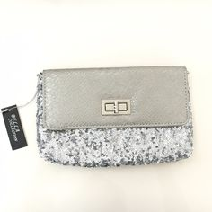 NWT Sequin Clutch NWT silver sequin clutch with snakeskin faux leather backside. Comes with detachable silver chain strap. Never used! Very cute evening accessory. Bags Clutches & Wristlets