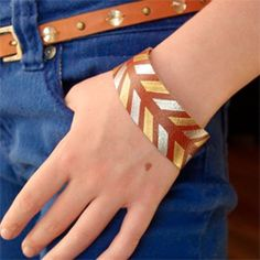 DIY painted leather cuffs are style current with metallics and geometric patterns.  And easy to make custom accessory for any outfit.