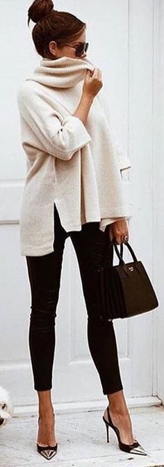 Winter white color mixed with black jeans...what a beautiful and great combination! Cozy enough for our Florida winter weather!