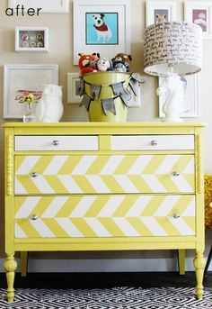 Isn't this fun?  She used painter's tape before she spray painted the stripes and drawers white...would be a fun project.