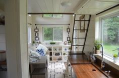 This is the stunning Mohican Tiny House by Modern Tiny Living, the builder's model home that's for sale at a discount in Columbus, Ohio. The house includes cream-painted poplar interior… Best Tiny House, Modern Tiny House, Tiny House Living, Tiny House Design, Tiny House Movement, Small Space Living, Small Spaces, Tiny House France, Tyni House