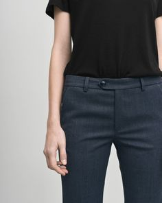 b90f45c5 Classic fit slacks that sit on waist with a slim cut hip. Slightly bootcut  leg