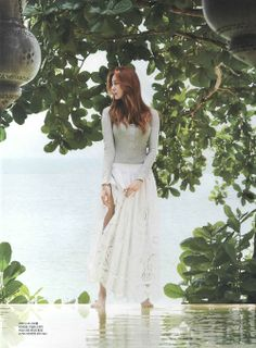 She is Uee from the Kpop group After School. Love her outfit and surroundings in this photo shoot.  -Lily #koreanfashion