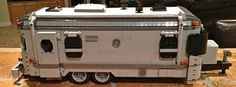Has anyone ever built a LEGO Airstream? I was to the LEGO store in Downtown Disney this weekend and they had LEGO everything - except an AirStream. Has anyone ever tried to make one from LEGOs? Lego Camper Van, Lego Vehicles, Lego Store, Cool Lego Creations, Downtown Disney, Lego Moc, Bricks, Legos, Man Cave
