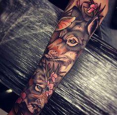 Bras tatoué