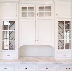 A lovely kitchen buit-in that features a herringbone tile treatment on the interior of the cabinets.