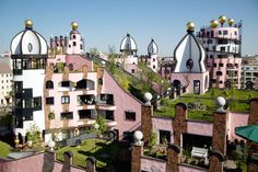 "Green roof on the Green Citadel. Again there was use of golden onion towers, something used in Hundertwasser's designs over and over. He once said, ""A golden onion tower on one's own house elevates the occupant to the status of a king."""