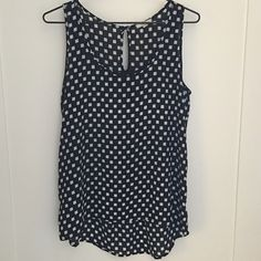 Pleione Silk Tank Perfect Condition.  Only worn 1-2 times.  Longer length in back.  Black tank with white square print with red dots.  Size Small.  No Trades!! Pleione Tops Tank Tops