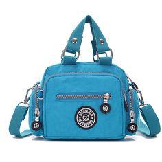 4e7d9341ba32 Tiny Chou Mini Solid Color Water Resistant Nylon Handbag Cross Body  Shoulder Bag for Women   Girls  Handbags  Amazon.com