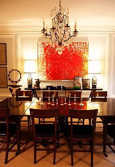 Kate & Andy Spade's Dining Room from The Selby.  I love the combination of the modern art, the dark traditional dining set, and the chandelier.