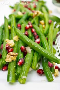 Green Beans with Pomegranates and Toasted Walnuts - These were a delicious accompaniment to Thanksgiving Dinner. The dressing and the pomegranate seeds add a nice tang to the crisp green beans.