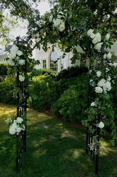 White garden rose arbor.  In bloom, ltd.