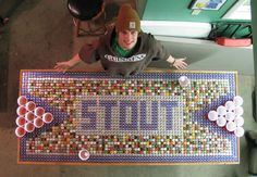 Beer Pong Table attending UW Stout out of beer bottle caps. Beer Cap Table, Bottle Cap Table, Beer Bottle Caps, Beer Pong Tables, Bottle Cap Art, Beer Caps, Bottle Top, Diy Bottle, Bottle Cap Projects