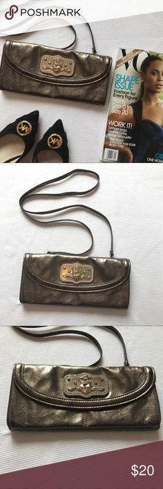 Kathy Van Zeeland Clutch/crossbody Versatile Clutch in a beautiful metallic color.  Comes with straps that are detachable. You can wear over the shoulder or as a crossbody Clutch... Don't forget to bundle and Save!! Kathy Van Zeeland Bags Clutches & Wristlets
