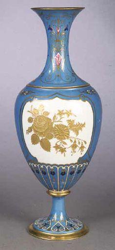 A French Porcelain Gilt-Decorated Baluster-Form Vase.