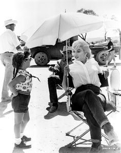 Marilyn Monroe and a sassy little girl on set of The Misfits.