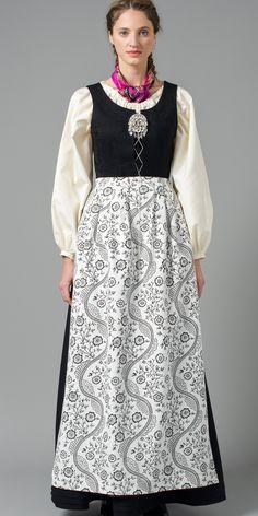 Nord-Norges Festdrakt med hvit skjorte og stormønstret forkle