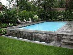 Risultati immagini per swimming pool above ground walls as patio edging