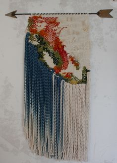 California Weaving. The weaving is inspired by a topographical map of the state. The indigo dyed rope suggests the Pacific Ocean and the welded arrow points westward.
