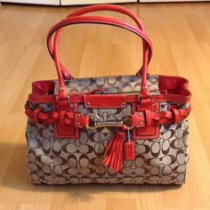 COACH large coral shoulder bag ❤️ COACH large shoulder bag. Coral colored leather handles and accent details. Classic brown coach patterned fabric. Zipper closure. Large zipper pocket inside as well as 2 small open pockets. No marks, stains, or signs of wear. EXCELLENT CONDITION, LIKE NEW! Barely used. Great for everyday use! Dimensions: 15 inches in length x 10 inches in height x 5.5 inches in width Coach Bags Shoulder Bags