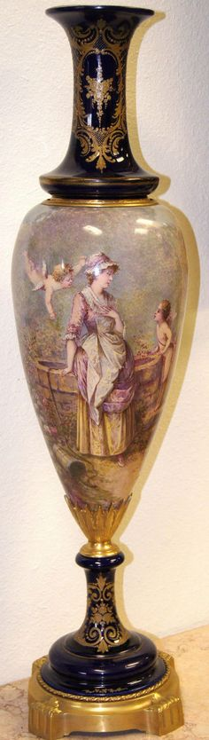 Sevres French Tall Painted Vase Mounted in Gilt Bronze. 19th century.