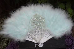 Reserved for Michele, Pastel Green Handheld Folding Fan, Fancy Feather Fan with Pearls and Sequins. $22.50, via Etsy.