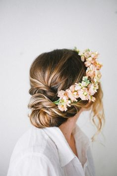 Maybe this flower styling with a half-up, half-down (not updo as here). Might be too much towards front, would want them to be more in the back and maybe a tiny bit on the side.