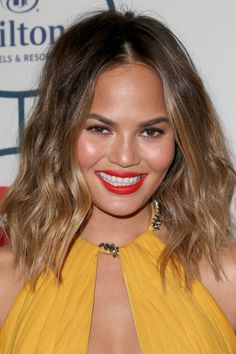 Chrissy Teigen Medium Wavy Cut - Chrissy Teigen was sexy-edgy at the pre-Grammy gala with her shoulder-length center-parted waves.